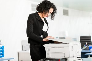 woman prepares documents for process serving