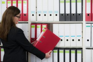 woman prepares documents for court filing